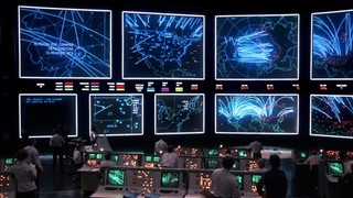 Multiple simulations of nuclear war running at once at the end of 1983's 'Wargames' in a massive NORAD commander center.