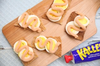 swedish knackebrod topped with an egg and kalles smoked roe