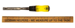 A screwdriver and ruler. The rules has the phrase
