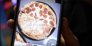 screenshot of a shane dawson video showing a chuck e. cheese's pizza