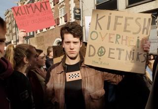 demonstrant tijdens de klimaatmars in Amsterdam