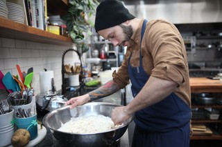 chef jaime young of sunday in brooklyn mixing dough for biscuits