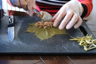 1550665146514-AA-Stuffing-the-vine-leaves