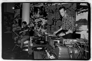 The multifaceted artist Christian Marclay deejaying at an opening at the New Museum of Contemporary Art in 1990. Photo by Catherine McGann, courtesy of Getty Images.
