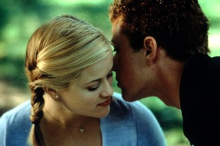 Reese Witherspoon listens as Ryan Phillippe whispers in her ear in a scene from the film 'Cruel Intentions', 1999. (Photo by Columbia Pictures/Getty Images)