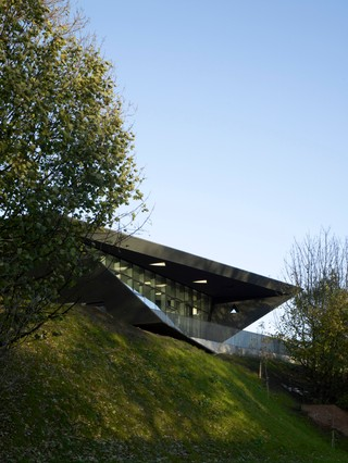 One of Zaha Hadid's earliest works, Maggie's Center in Fife is perched against a clear blue sky. View Pictures/UIG, courtesy of Getty Images.