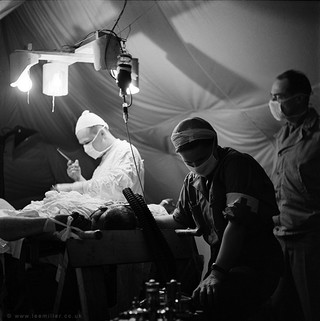 1551958538868-Surgeon_and_anaesthetist_by_Lee_Miller
