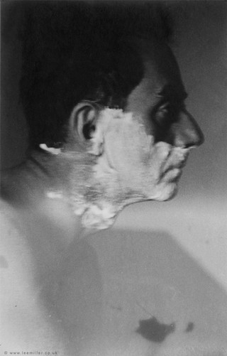 1551958540249-Man_Ray_Shaving_by_Lee_Miller