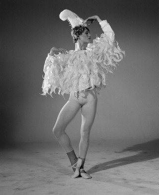 Victor wears top by Y/PROJECT, bodysuit and bloomers by CHRISTIAN DIOR, diadem by NINA RICCI, slippers by GRISHKO.