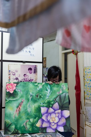 Tung with her art.