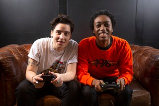 two non-binary friends playing video games