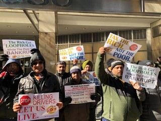 People protesting the congestion pricing fee targeting taxi drivers.