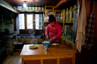 1554223521625-Mingma-Sherpa-cooking-dinner-at-her-familys-teahouse-in-Phortse-Gaon-2