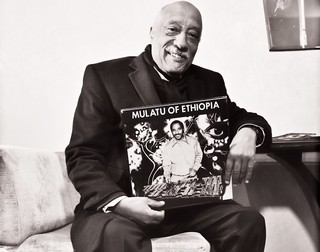 1554395384552-Mulatu-Astatke-with-vinyl