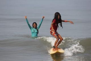 1554905463924-Ishita-teaching-local-girl-Tejaswini-how-to-surf