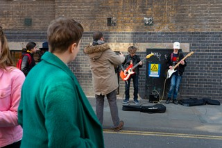 watching buskers on brick lane for noisey