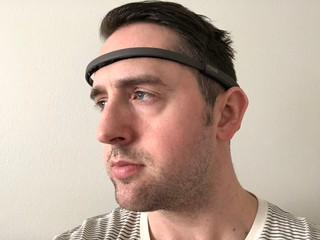 The author wearing an electronic headband that goes across his forehead.