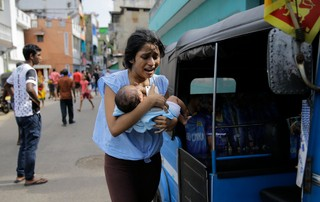 1555949339960-AP_19112432164428A Sri Lankan woman living near St. Anthony's shrine runs for safety with her infant after police found explosive devices in a parked vehicle in Colombo, Sri Lanka, Monday, April 22, 2019. Easter Sunday bombings that ripped through churches and luxury hotels killed more than 200 people. (AP Photo/Eranga Jayawardena)