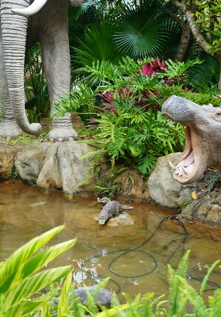 Fiberglass statues of a platypus, a hippo, and an elephant in the gardens of Noah's Ark Hong Kong