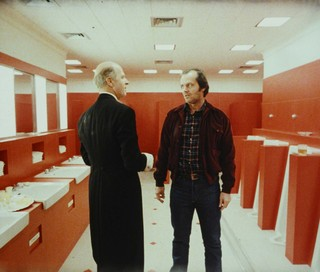 The Shining, directed by Stanley Kubrick (1980; GB/United States). Grady (Philip Stone) and Jack Torrance (Jack Nicholson). Still image. © Warner Bros. Entertainment Inc.