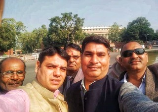 1557480436207-Amit-Sharma-centre-in-a-selfie-outside-Indian-Parliament-with-supporters