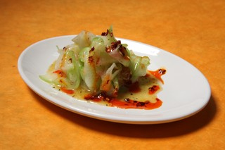 a plate of raw chayote salad with lemon curd vinaigrette and chili oil