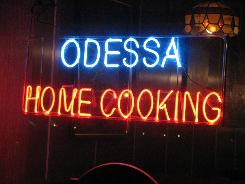 the blue and red neon sign at odessa home cooking in the east village