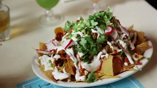 a plate of nachos from the commodore in williamsburg, brooklyn
