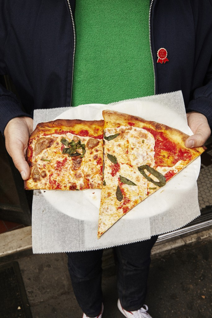 two slices of pizza from prince street pizza