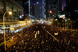 Protesters flood the streets of Hong Kong demanding that the region's leaders step down.
