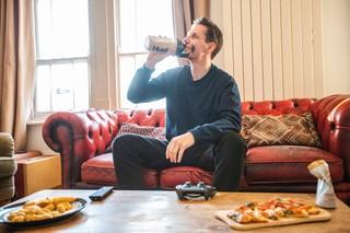 man drinking huel