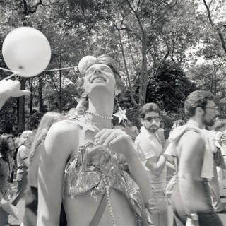 1561495474502-1977_06_PrideMarchNYC_lookUp