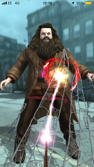 A rather uncanny-valley version of Hagrid gets blasted by a spell in Wizards Unite.