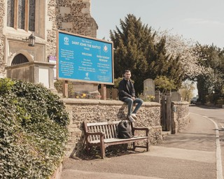 man sitting in front of church