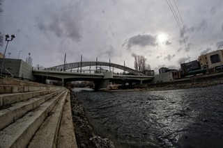 1562778590245-A-view-of-the-main-bridge-where-most-incidents-take-place-from-the-bank-of-Ibar-river-The-bridge-is-under-24h-protection-by-Kfor-or-Kosovo-police