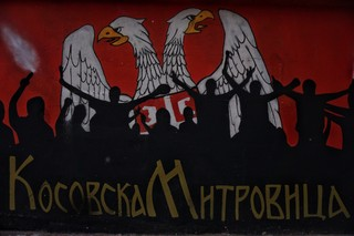 1562778626558-A-mural-in-the-center-of-the-northern-Kosovska-Mitrovica-It-was-painted-years-ago-and-has-slowly-became-the-symbol-of-the-northern-part-of-the-city