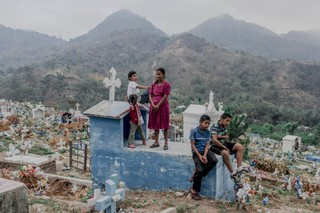 1562964118655-Relatives-and-friends-of-Sgt-Pablo-Candido-Vega-at-the-cemetery-in-Panchimalco-El-Salvador-in-April-2015-c-Fred-Ramos-1