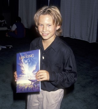 jonathan taylor thomas with the lion king book