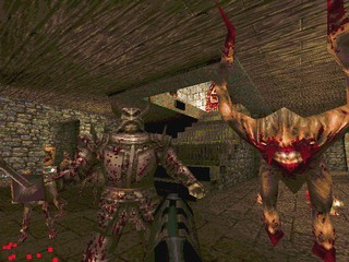 A blurry, pixelated medieval knight stands next to a hideous but nonsensically angular creature comprised of crude polygons in the original Quake, which was extreme for its day.