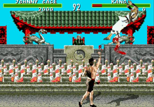 Mortal Kombat - Genesis version image featuring Johnny Cage killing Kano in a spray of blood.