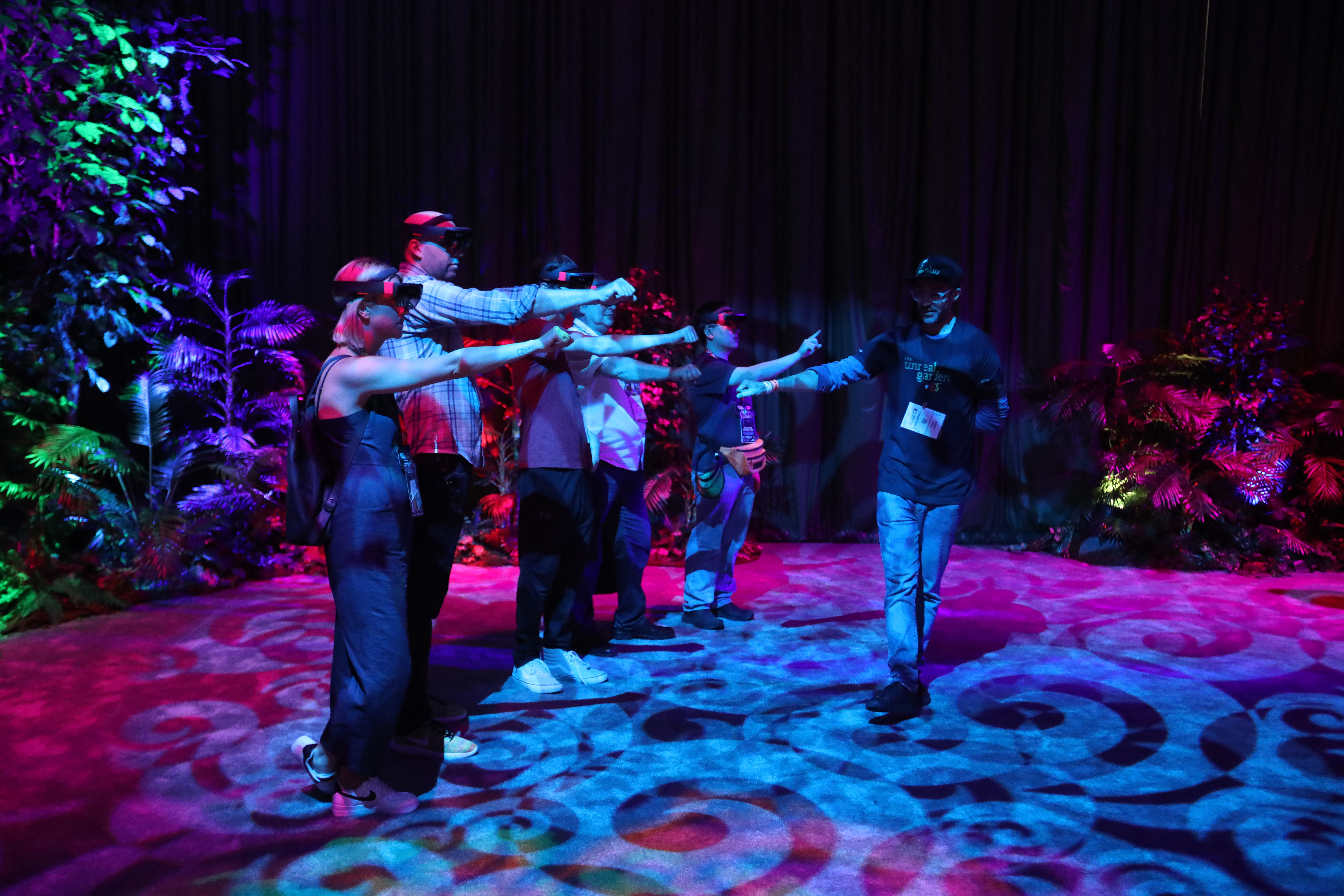 Gamers take part in a VR game around E3