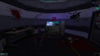 A computer terminal surrounded by blood-spattered walls in System Shock 2