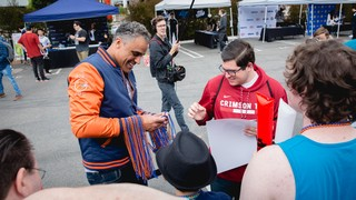 Rick Fox signs fan autographs outside the LCS studio