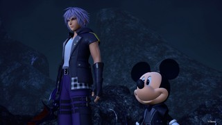 Mickey Mouse in Kingdom Hearts 3 standing with Sora against a night sky.