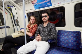 man in 70s clothing on tube