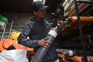 1568620655254-Mountain-guide-and-rescue-specialist-Mingma-David-Sherpa-checking-an-oxygen-cylinder