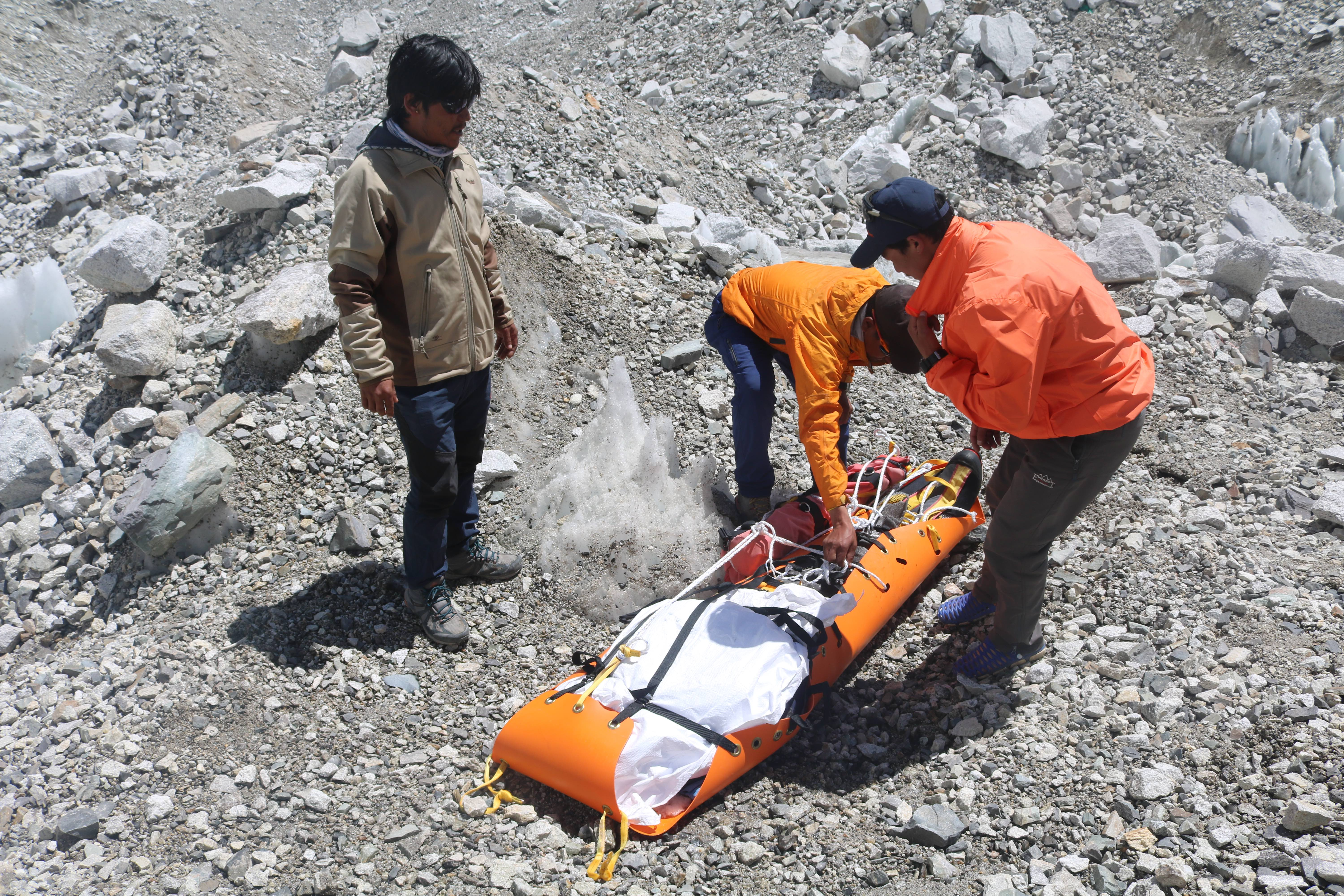 1568620875008-Rescue-personnel-wrapping-a-dead-body-found-on-Everest