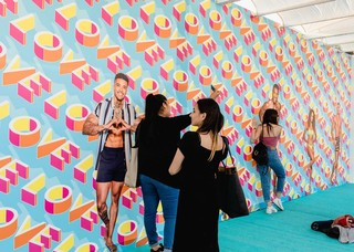 Visitors to Love Island: The Experience, a pop-up event for the ITV2 reality show. Photo by Bekky Lonsdale