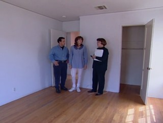1569857376334-Mitch-and-Jane-with-realtor-in-dud-house-2