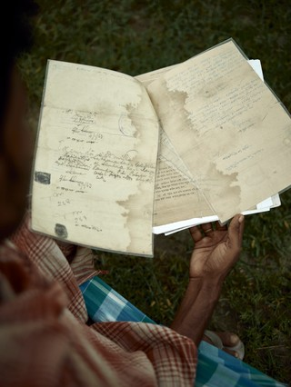 Land patta (land deed) documents, often decades old and damaged from floodwater, are crucial to NRC verification process.